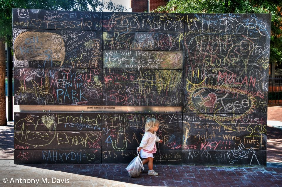 A little girl with her bag of chalk