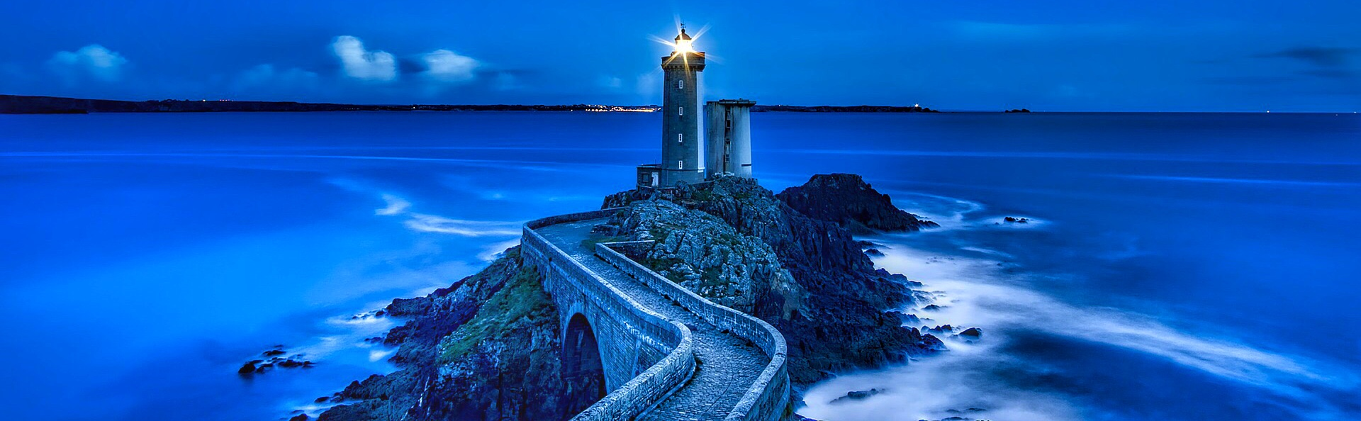 Blue panorama with lighthouse